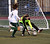 Pacific Collegiate School's goal keeper Nicole Trenchard makes a save before being bowled over by Harbor's Ellie Loustalot early in their Central Coast Section D-III girls soccer match Wednesday, Feb. 20, 2013, at Soquel High in Soquel, Calif. Harbor won 2-0. <a href=