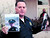 Santa Cruz Police Chief Kevin Vogel holds pictures of slain detectives Elizabeth Butler and Loran 'Butch' Baker during a press conference Wednesday morning. (Shmuel Thaler/Sentinel)