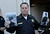 Santa Cruz Police Chief, Kevin Vogel holds photo of slain Santa Cruz police officers, detective Elizabeth Butler and detective Sgt. Loran