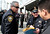 Capitola Police Chief Rudy Escalante, left, arrives at HP Pavilion Thursday morning as Santa Cruz Police Deputy Chief Steve Clark goes over last minute details of the memorial service for Santa Cruz Police Department's fallen officers shortly before the ceremony begins. (Shmuel Thaler/Sentinel)