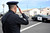 San Jose police Sgt. Brian Shab salutes as the Santa Cruz procession arrives at the HP Pavilion in San Jose, Calif. on Thursday, March 7, 2013. Thousands are expected at the pavilion to mourn the loss of the 2 Santa Cruz police officers Loran 
