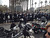 A silent crowd gathers as police line Autumn St. in San Jose, Calif., for the funeral services of Elizabeth Butler and Loran 