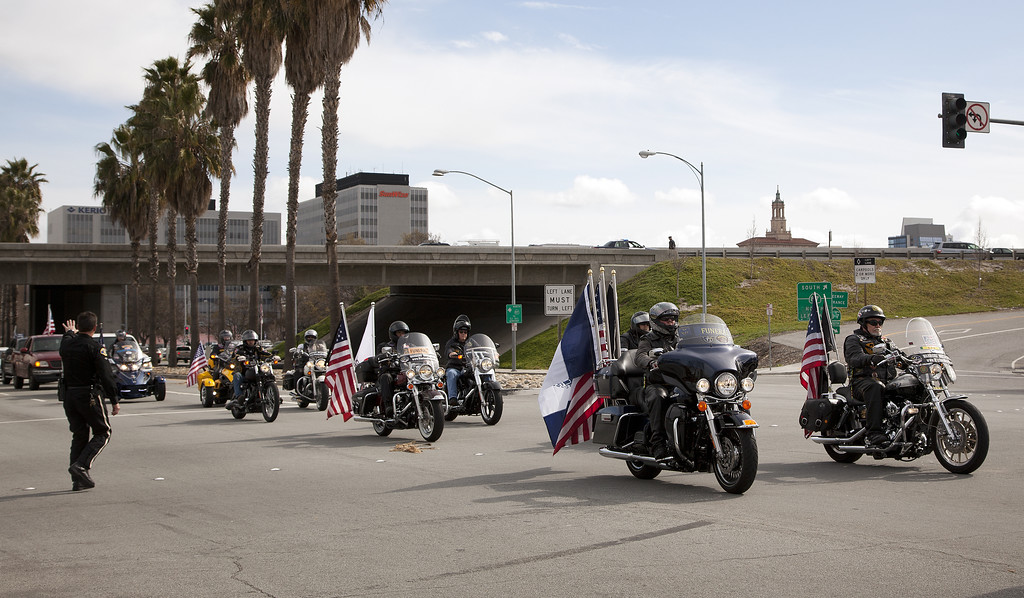 ". The memorial procession for Santa Cruz city police officers Loran ""Butch\"" Baker and Elizabeth Butler passes through downtown San Jose, Calif. on Thursday, March 7, 2013.  (LiPo Ching/Staff)"