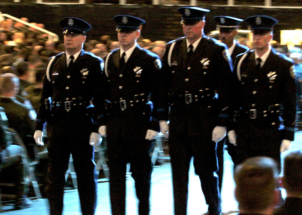 . A Santa Cruz Police Department honor guard participates in the memorial for detective Elizabeth Butler and detective Sgt. Loran \'Butch\' Baker. (Shmuel Thaler/Sentinel)