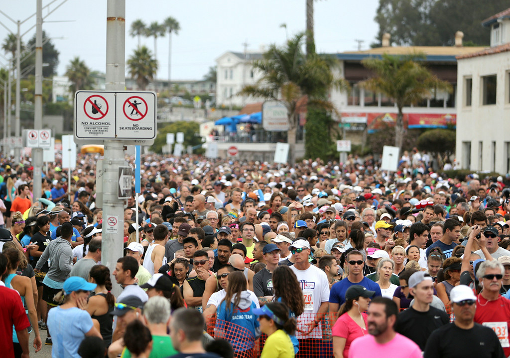 . Thousands crowd Beach Street in Santa Cruz on Sunday morning to participate in the 42nd annual Wharf to Wharf. (Kevin Johnson -- Santa Cruz Sentinel)
