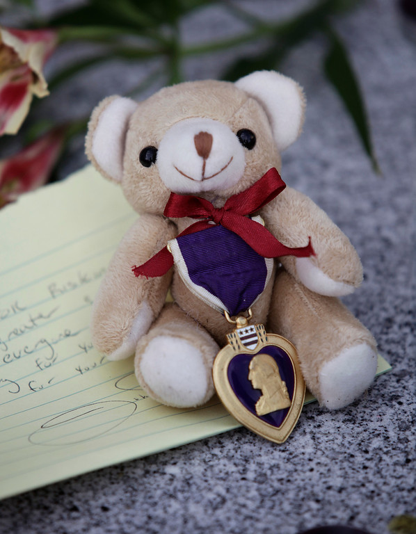 ". A bear with a Purple Heart and a hand written note was left at a makeshift memorial for slain Santa Cruz police officers, detective <a href=""http://www.santacruzsentinel.com/localnews/ci_22676928/loran-butch-baker-28-year-veteran-leaves-legacy\"">Sgt. Loran \""Butch\"" Baker</a> and detective <a href=\""http://www.santacruzsentinel.com/localnews/ci_22676931/santa-cruz-police-detective-elizabeth-butler-policing-was\"">Elizabeth Butler</a> in front of the police department in Santa Cruz, Calif. on Wednesday, Feb. 27, 2013. The pair were <a href=\""http://www.santacruzsentinel.com/localnews/ci_22674808/breaking-2-officers-1-suspect-shot-santa-cruz\"">gunned down yesterday</a while investigating a possible domestic violence or sexual assault when a suspect fired at them. The gunman, Jeremy Peter Goulet, was later gunned down when he exchanged gunfire with police during a manhunt. (Gary Reyes/ Staff)"