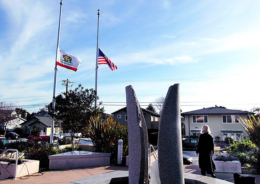 . Flags fly at Half-Staff Wednesday at Santa Cruz Police Department Headquarters on Center Street. (Shmuel Thaler/Sentinel)