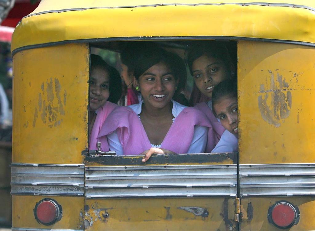 . Girls heading home from school Vikram rickshaw in Amritsar, India. Shmuel Thaler/Sentinel