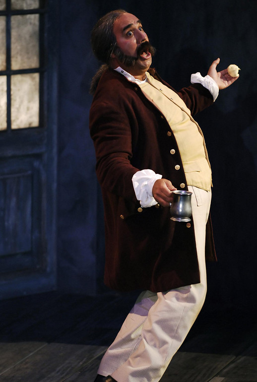""". Tommy A. Gomez as Sir Toby Belch  in Shakespeare Santa Cruz\'s 2005  production of \""""Twelfth Night.\"""" (Photo courtesy of Steve DiBartolomeo.)"""