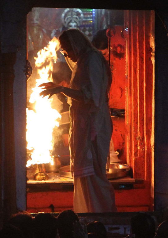 . A Hindu faithful takes in the power of the large flames from an oil lamp as she leaves Aarti in Haridwar, India Friday. Photos by Shmuel Thaler/Santa Cruz Sentinel