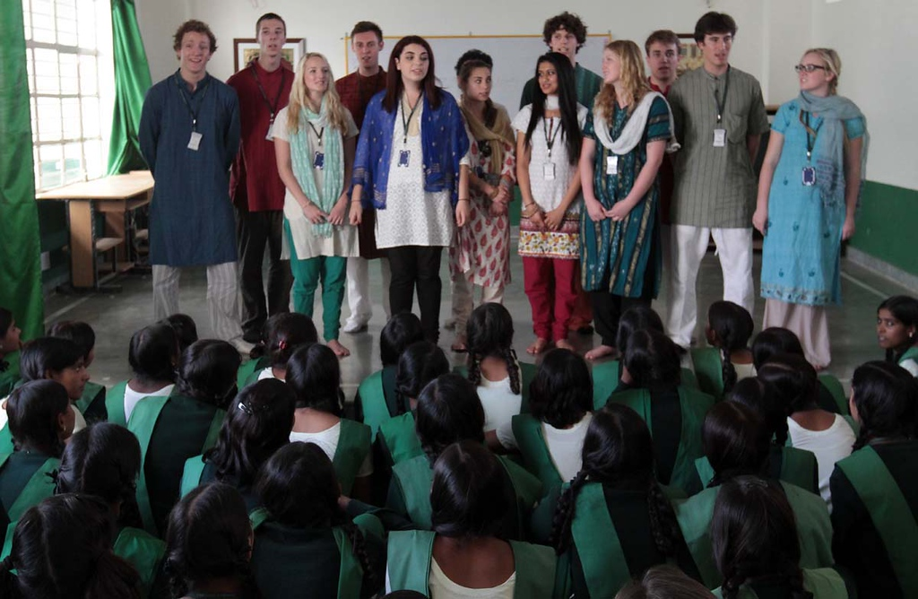 . The senior class of Mount Madonna School from Watsonville, Calif., arrive at Pardadi Pardada School in Anupshahr, India on March 25, 2013, and meet some of the school\'s 1,200 students.