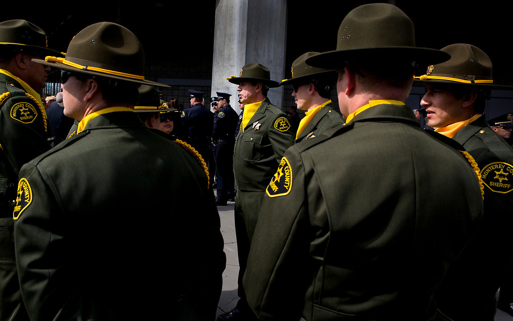 . Monterey County Sheriffs gather outside of the HP Pavilion in San Jose on Thursday morning to honor Santa Cruz Police detectives Sgt. Loran \'Butch\' Baker and Elizabeth Butler. (Kevin Johnson/Sentinel)