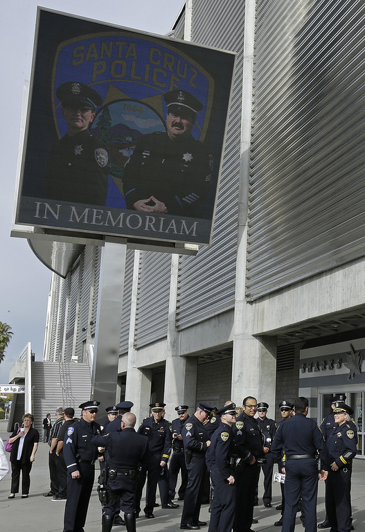 . Law enforcement personnel gather outside HP Pavilion where a memorial service is to be held in honor of slain Santa Cruz police Sgt. Loran Baker and detective Elizabeth Butler Thursday, March 7, 2013, in San Jose, Calif. Baker and Butler were shot to death on Feb. 27, after arriving at the home of Jeremy Peter Goulet to question him about a misdemeanor sexual assault. (AP Photo/Ben Margot)
