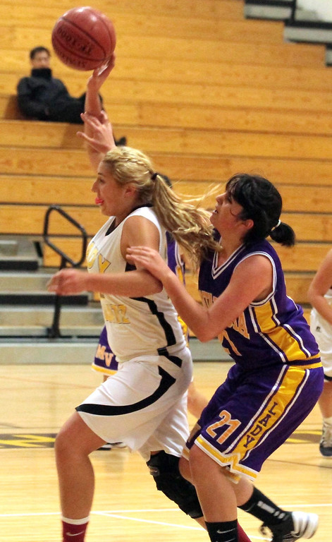 . Watsonville\'s Brianna Cueva is fouled by Monta Vista\'s Nassim Moallum during the first half in their Central Coast Section Division I playoffs game in Watsonville, Calif., on Tuesday, Feb. 19, 2013. Monta Vista won the first-round game 54-49.  (Shmuel Thaler/Sentinel)