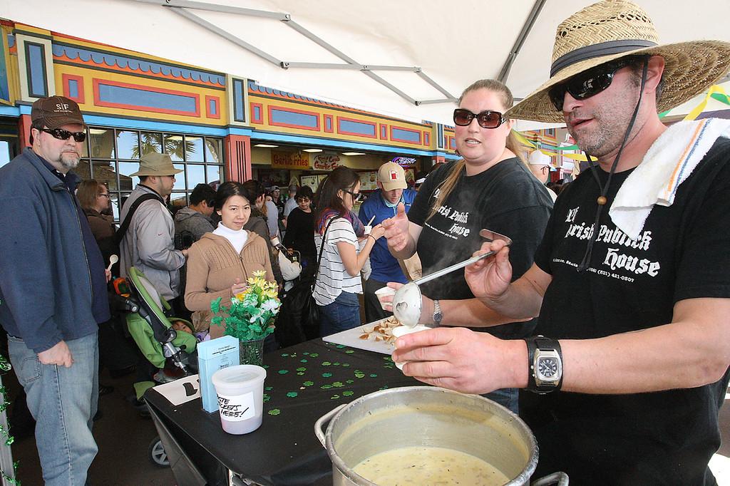 . Zach Willis, head chef at The Parish House in Santa Cruz, serves up some of his restaurant\'s entry in the Boardwalk\'s 32nd annual Clam Chowder Cook-Off in Santa Cruz, Calif., on Saturday, Feb. 23, 2013. (Dan Coyro/Sentinel)