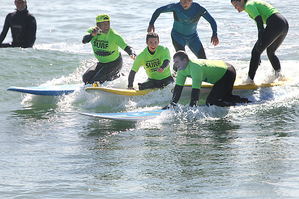 . Two war-wounded soldiers get the ride of their lives Tuesday, April 16, 2013, with the help of Santa Cruz surfers and Operation Surf at Cowell\'s surf break in Santa Cruz, Calif.  (Dan Coyro/Sentinel)