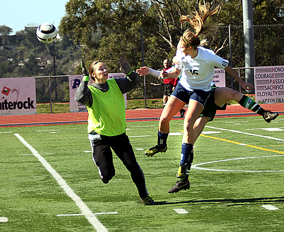 . Soquel High\'s Kendra Bonsall shoots a header over the charging Harbor High goal keeper, but the shot traveled wide of the net during the game Saturday, Feb. 23, 2013, at Aptos High in Aptos, Calif. The Pirates won 1-0 in Central Coast Section play. (Dan Coyro/Sentinel)