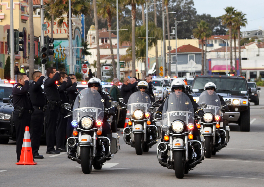". A convoy of Santa Cruz Police Department motorcycle officers lead limousines bearing family members of the slain police detectives, Thursday, March 7, 2013 in Santa Cruz, Calif. Detectives Sgt. Loran ""Butch\"" Baker and Officer Elizabeth Butler were were killed by Jeremy Goulet after they came to his house on Feb. 26 while investigating a misdemeanor sexual assault case. Goulet was killed in a subsequent chase and shootout. Hundreds of law enforcement officials drove 30 miles from Santa Cruz Thursday to a memorial planned in San Jose. (AP Photo/Thomas Mendoza)"