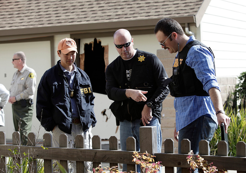 ". Members of the FBI and local police investigators at the scene of a shoot out between suspect Jermy Peter Goulet and Santa Cruz police on Doyle St. in Santa Cruz, Calif. on Wednesday, Feb. 27, 2013.  Santa Cruz police officers, detective Sgt. Loran ""Butch\"" Baker and detective Elizabeth Butler were believed to be gunned down by Goulet yesterday while investigating a possible domestic violence or sexual assault when the suspect fired at them. Goulet was later gunned down and killed in this area when he exchanged gunfire with police during a manhunt. (Gary Reyes/ Staff)"