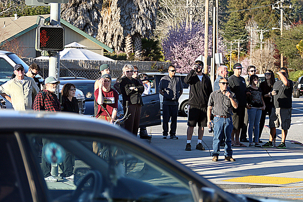 . Spectators gather at the corner of N. Branciforte Avenue and Water Street as SWAT teams and law enforcement poured into the area surrounding the shooting scene.  (Dan Coyro/Sentinel)