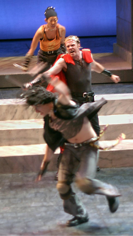 . John G. Preston (Coriolanus), Ai Ozawa(Volscian, background) and Jordan Kaplan (Volscian, foreground) in Shakespeare Santa Cruz\'s production of Coriolanus. (Sentinel file)