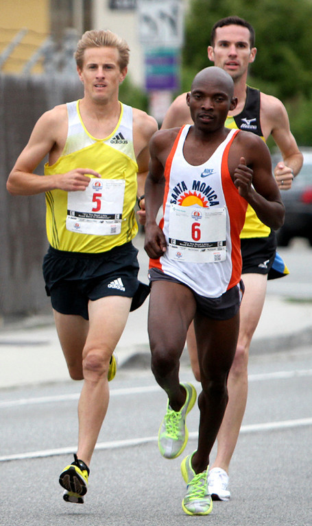 . Aptos local Brett Gotcher (5), who finished third, keeps pace with the elite runners during the 2013 Wharf to Wharf race on Sunday. (Kevin Johnson/Sentinel)