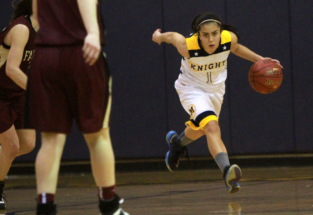 . Menlo\'s Lauren Lete drives the ball down court during a game against Scotts Valley during in CCS Div. IV semifinals game at Notre Dame High School in Belmont on Tuesday, Feb. 26, 2013.  (Kirstina Sangsahachart/ Daily News)