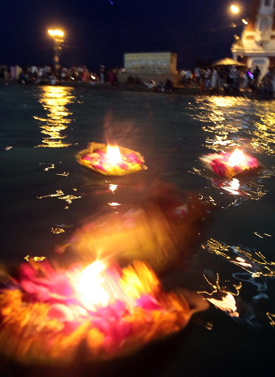 . Candle-lit flower baskets float down the Ganges River in Haridwar, India as the daily Aarti ceremony concludes on Friday. Photos by Shmuel Thaler/Santa Cruz Sentinel