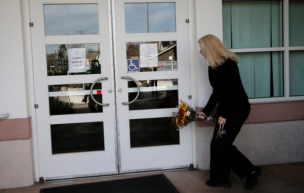 ". A woman who did not want to be identified places flowers for slain Santa Cruz police officers, <a href=""http://www.santacruzsentinel.com/localnews/ci_22676928/loran-butch-baker-28-year-veteran-leaves-legacy\"">Sgt. Loran \""Butch\"" Baker</a> and detective <a href=\""http://www.santacruzsentinel.com/localnews/ci_22676931/santa-cruz-police-detective-elizabeth-butler-policing-was\"">Elizabeth Butler</a> in front of the police department in Santa Cruz, Calif. on Wednesday, Feb. 27, 2013. The pair were <a href=\""http://www.santacruzsentinel.com/localnews/ci_22674808/breaking-2-officers-1-suspect-shot-santa-cruz\"">gunned down yesterday</a while investigating a possible domestic violence or sexual assault when a suspect fired at them. The gunman, Jeremy Peter Goulet, was later gunned down when he exchanged gunfire with police during a manhunt. (Gary Reyes/ Staff)"