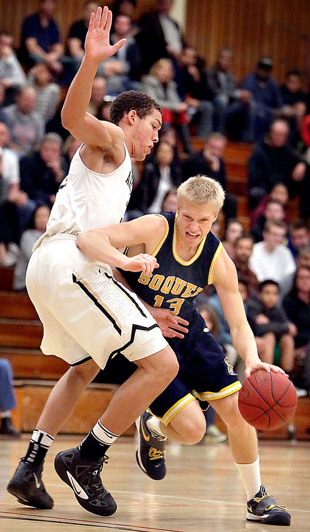 """. Soquel High\'s Sam Walters plows his way through Mitty\'s defense as he pushes his way toward the net on Friday, Feb. 22, 2013, during the Central Coast Section boys open division basketball quarterfinals game at Piedmont Hills High in San Jose, Calif. <a href=\""""http://www.santacruzsentinel.com/soquel/ci_22652785\"""">Read about how the Knights almost upset the top seed here.</a> (Kevin Johnson/Sentinel)"""