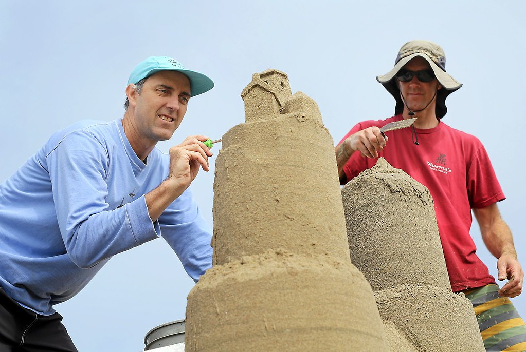. Brothers Jeff Brown, left, and Andrew Brownstone begin carving details into their sand castle at Capitola Beach on Saturday during the annual sand castle competition. (Kevin Johnson -- Santa Cruz Sentinel)