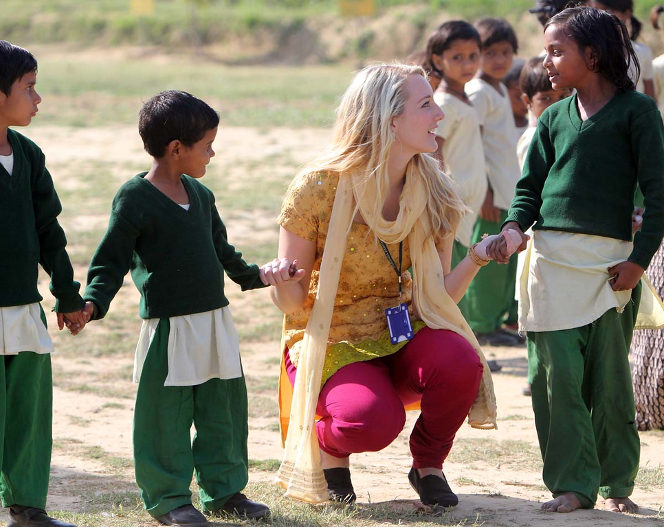 . Mount Madonna School senior Vyvyanne Mackey, of Corralitos, spends some time with students at Pardada Pardadi School in Anupshahr, India on March 26.