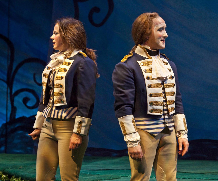 """. Viola (Lenne Klingaman, left) disguised as \""""Cesario,\"""" unexpectedly encounters her twin brother Sebastian (Jesse James Thomas, right) in Shakespeare Santa Cruzís 2012 production of \""""Twelfth Night.\"""" (Courtesy: Shakespeare Santa Cruz)"""
