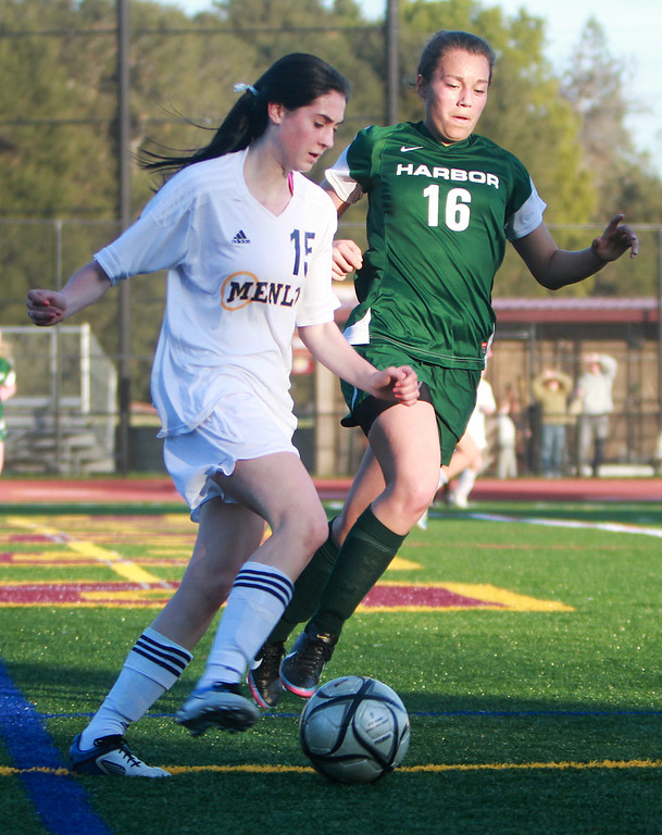 . Menlo\'s Daria Sprague keeps the ball away from against Harbor\'s  Xenia Marquez in the first half during a CCS Div. III semifinal game at Menlo-Atherton High School in Atherton on Wednesday, Feb. 27, 2013. (Kirstina Sangsahachart/ Daily News)