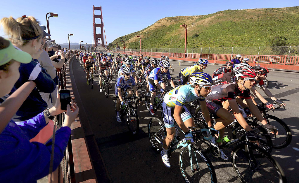 . USA team BMC in red, including overall winner  Tejay van Garderen in yellow, roll across the Golden Gate Bridge during the final stage of the Tour of California, Sunday May 19, 2013 from San Francisco to Santa Rosa.  (AP Photo/The Press Democrat,Kent Porter )