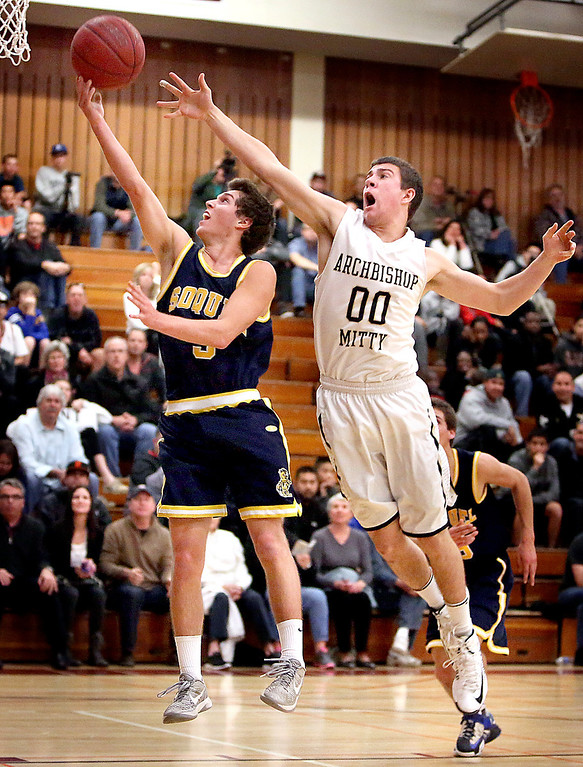 . Soquel High\'s Tucker Wiget drives toward the basket with Mitty defense on his heels to score during the second quarter of the Central Coast Section boys basketball quarterfinals at Piedmont Hills High in San Jose, Calif. on Friday, Feb. 22, 2013. (Kevin Johnson/Sentinel)