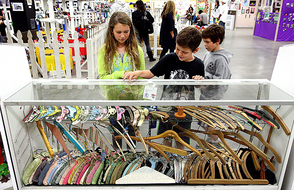 . Stacey Grant\'s hanger collection took garnered a first place ribbon at the Santa Cruz County Fair Tuesday and drew some fascinated fair-goers.  (Dan Coyro/Sentinel)