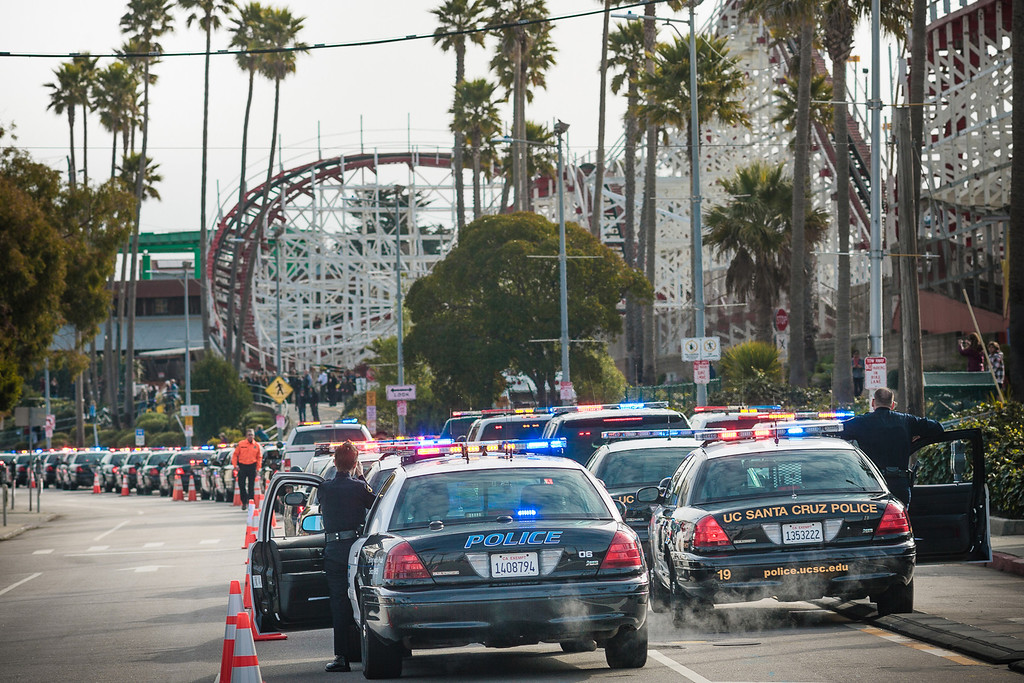 ". The motorcade is lined up near the Santa Cruz Beach Boardwalk for fallen SCPD officers Elizabeth Butler and Loran ""Butch\"" Baker. The memorial services were at HP Pavilion in San Jose, Calif., March 7, 2013. (Paul Winner/Contributed)"