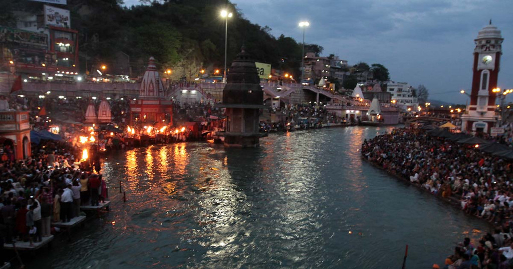 . Flames rise oil lamps along the Ganges River in Haridwar, India on Friday as Aarti gets under way. Photos by Shmuel Thaler/Santa Cruz Sentinel
