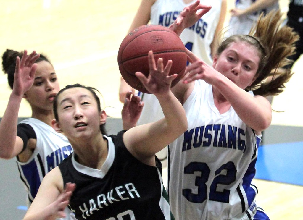""". Monte Vista Christian School freshman Savhanna Nevin grabs a rebound for the Mustangs over Harker\'s Rebecca Liu on Thursday, Feb. 21, 2013. MVC won the second-round Central Coast Section Division IV girls basketball game 53-36 in Watsonville, Calif. <a href=\""""http://www.santacruzsentinel.com/sports/ci_22642680\"""">Read more here.</a> (Shmuel Thaler/Sentinel)"""