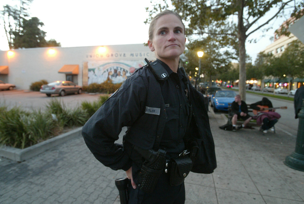 . Santa Cruz police officer Elizabeth Butler patrols along Pacific Avenue in 2005. Butler, who grew up in Los Angeles, was killed Tuesday, Feb. 26, 2013, in a shooting in Santa Cruz, Calif. (Shmuel Thaler/Sentinel file). <a href=\'http://www.santacruzsentinel.com/localnews/ci_22684042/elizabeth-butler-38-santa-cruz-police-detective-and\'>See story</a>.
