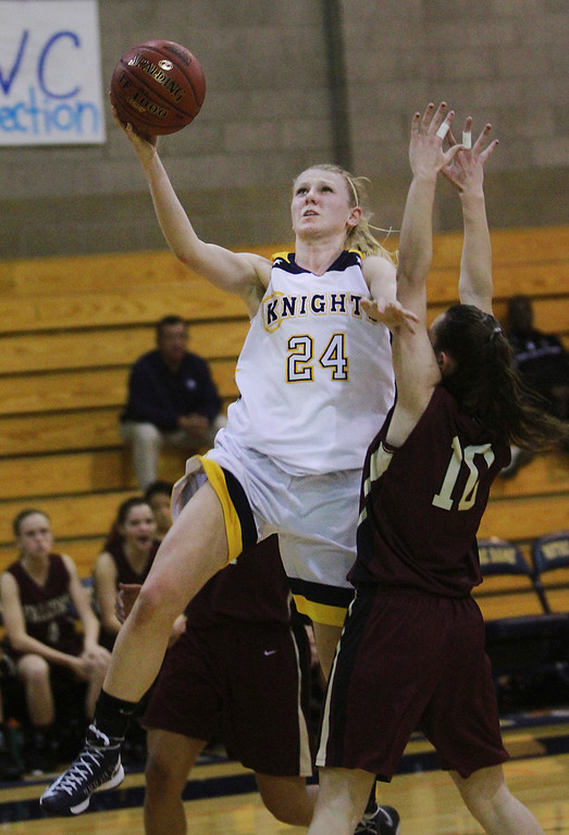 . Menlo\'s Maddie Price attempts a layup in the third quarter against Scotts Valley\'s Mandy Silver during a game CCS Div. IV semifinals at Notre Dame High School in Belmont on Tuesday, Feb. 26, 2013.  (Kirstina Sangsahachart/ Daily News)