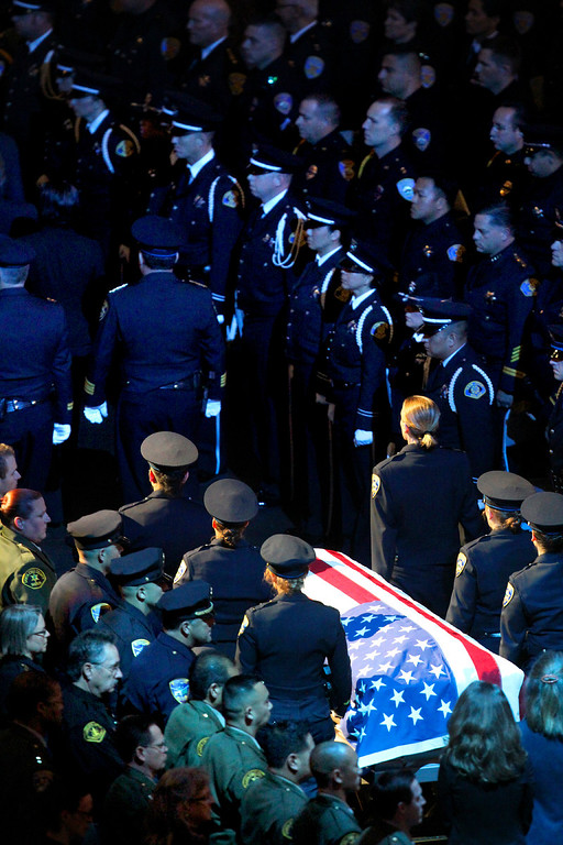 . Santa Cruz police pall bearers bring the casket of detective Elizabeth Butler out of HP Pavilion after the memorial service for Butler and detective Sgt. Loran \'Butch\' Baker Thursday. (Shmuel Thaler/Sentinel)