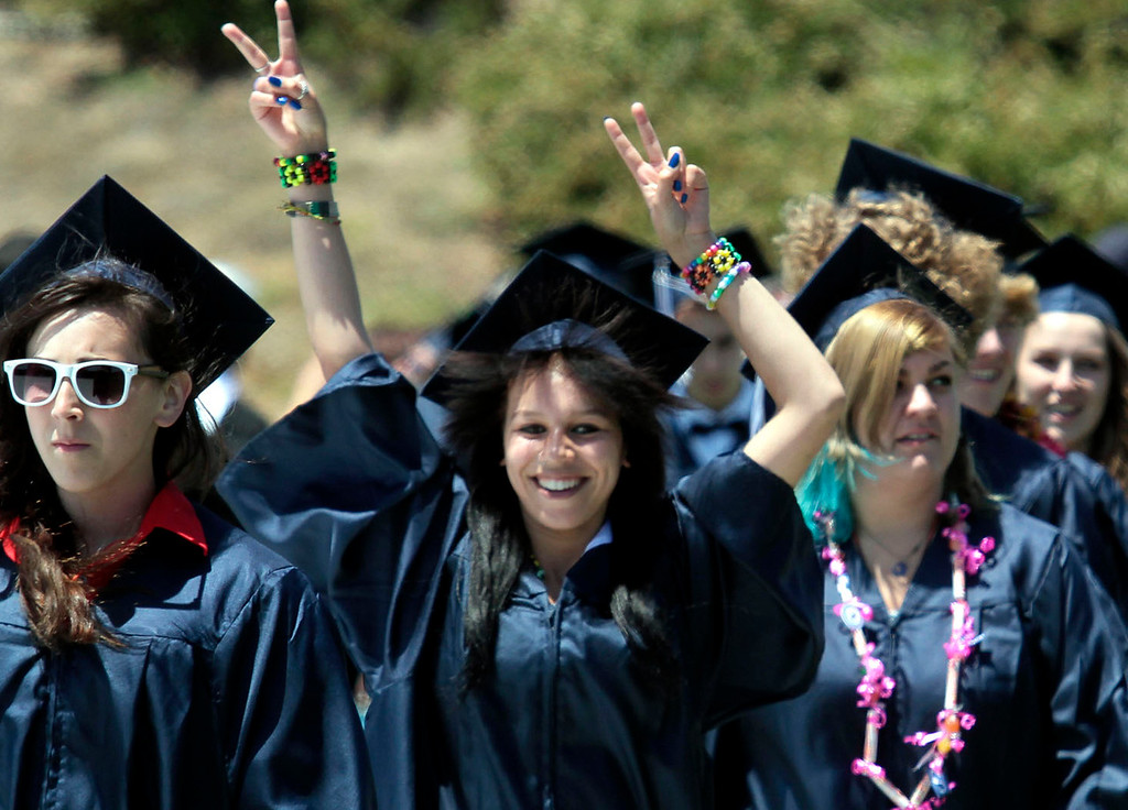 . The Aptos High School senior class heads in to commencement to the sound of \'Pomp and Circumstance\' at Carl Connelly Stadium at Cabrillo College Thursday afternoon. (Shmuel Thaler/Sentinel)