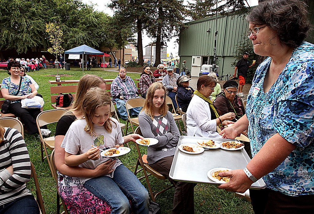 . Laura Rider passes out pie slices to audience watching the apple pie contest judging Tuesday at the Santa Cruz County Fair.