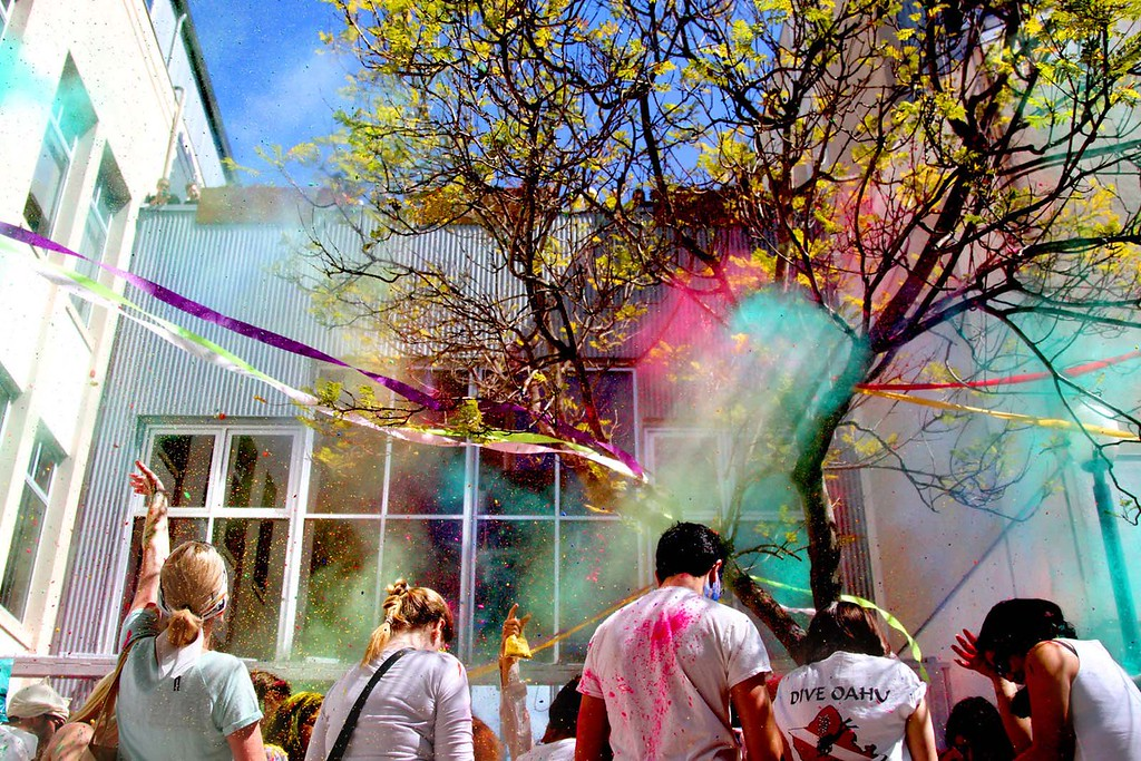 . Holi Festival participants throw colored powder into the air during the Hindu celebration of the arrival of spring at the Museum of Art and History in Santa Cruz, Calif., on Saturday, March 30, 2013.