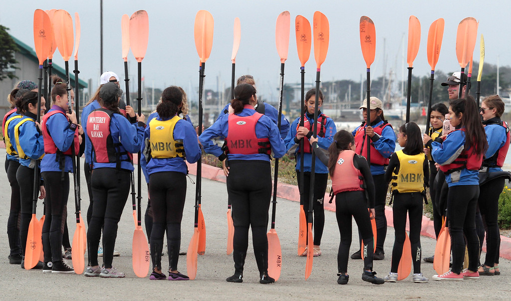 . Safety preparation before setting out. Young Women in Science Kayak in Elkhorn Slough (Shmuel Thaler/Sentinel)