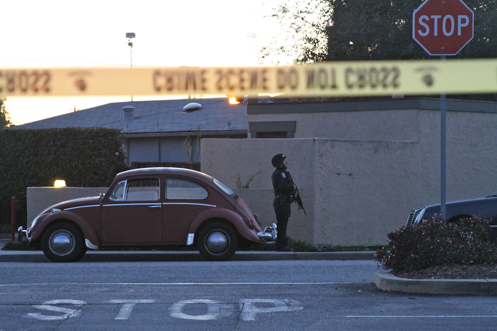 . A police officer secures the shooting scene near N. Branciforte Avenue and Doyle Street Tuesday, Feb. 26, 2013 in Santa Cruz, Calif., where two Santa Cruz Police Detectives were shot and killed. The officers were killed while investigating a sexual assault, and a suspect was also fatally shot, authorities said. (AP Photo/Thomas Mendoza)
