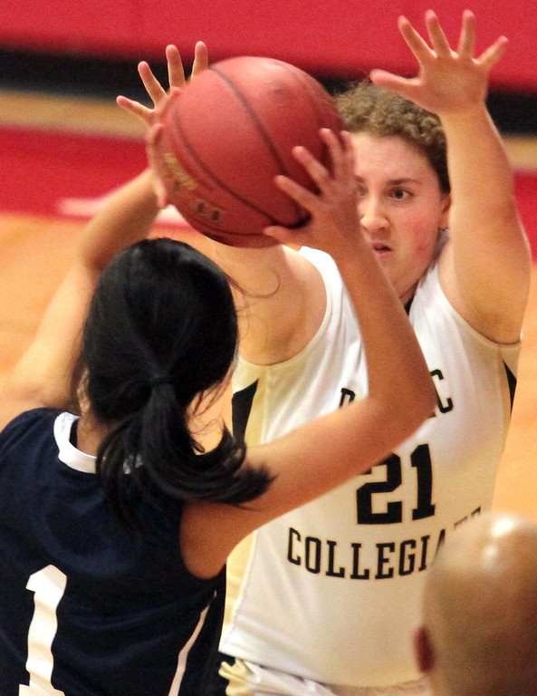. Pacific Collegiate\'s Margi Howard keeps up the defensive intensity in the paint Tuesday. (Shmuel Thaler/Sentinel)