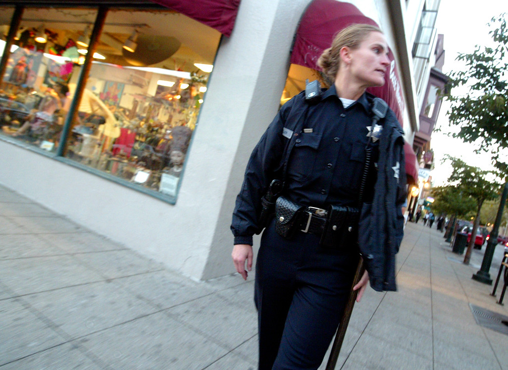 . Santa Cruz Police officer Elizabeth Butler keeps things safe on Pacific Avenue during a 2008 patrol. (Shmuel Thaler/Sentinel)
